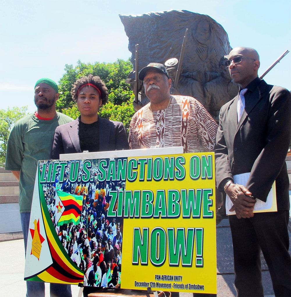 "Black activists holding banner saying ""Stop U.S. Sanctions on Zimbabwe Now!"""